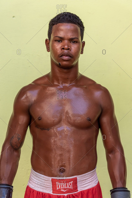 September 4, 2019: Isolated portrait of cuban boxer sweaty and wearing gloves. Havana, Cuba