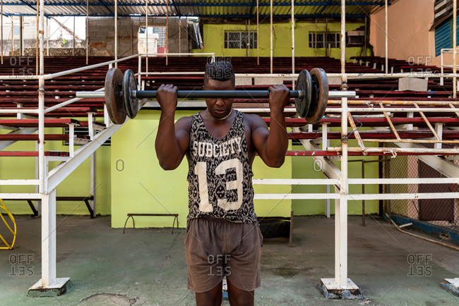 September 4, 2019: Boxer lifting weights in a gym. Havana, Cuba