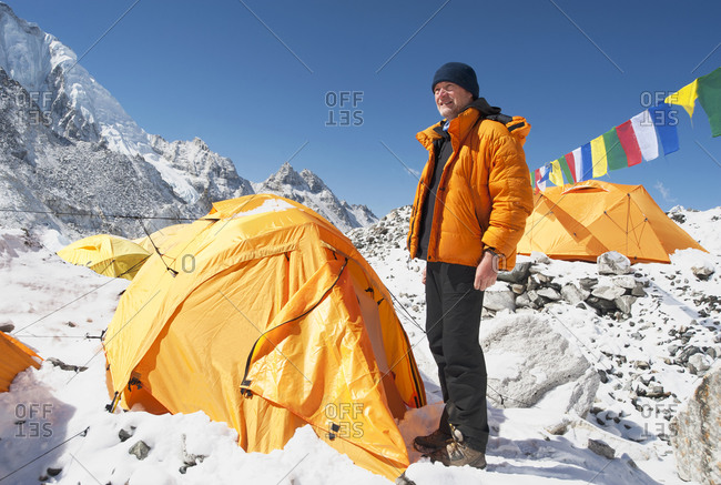 Man standing at base camp tent