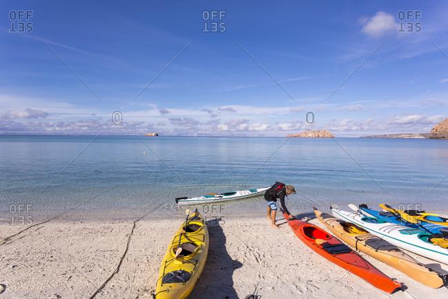 Isla Espiritu, Sea of Cortes, Mexico - October 8, 2020: Colorful kayaks lying on the beach, Isla Espiritu, Sea of Cortes