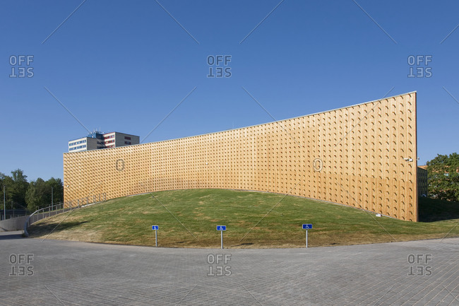 Estonia - September 22, 2020: Modern university buildings, wooden beams projecting from a curved wood cladding wall, on a curved ground surface