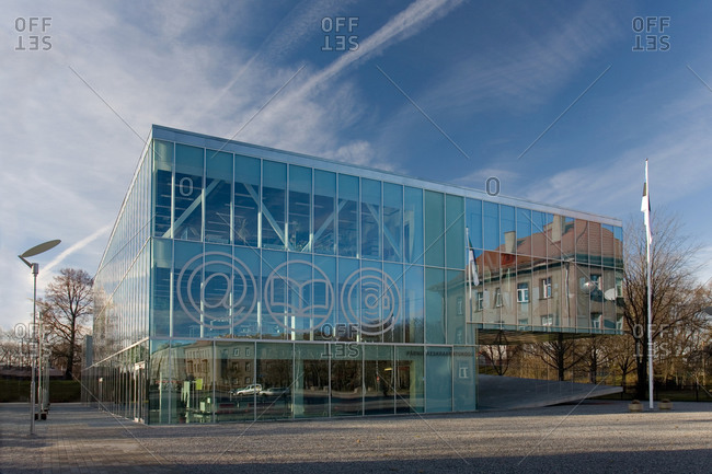 Estonia - September 22, 2020: The exterior glass walls of a modern library building, internet icons etched on glass