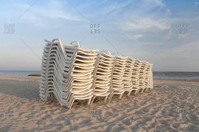 Stacked Lounge Chairs on a Beach