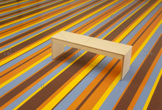 Wooden Bench on a vibrant Striped Floor