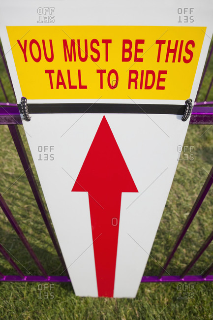 Height Requirement Sign In Front Of Amusement Park Ride