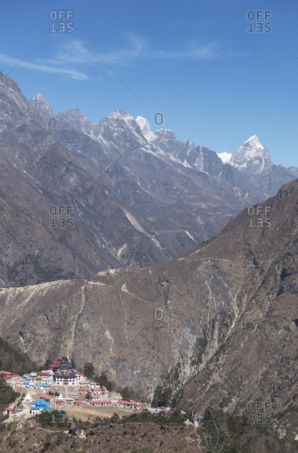 View from height over the Temboche monastery complex in the Khumbu region, steep mountains and deep valleys
