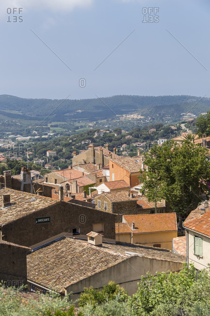 Scenic overview of quaint mountainside town of bormes-les-mimosas, province-Alpes-cote d azur, france on sunny day