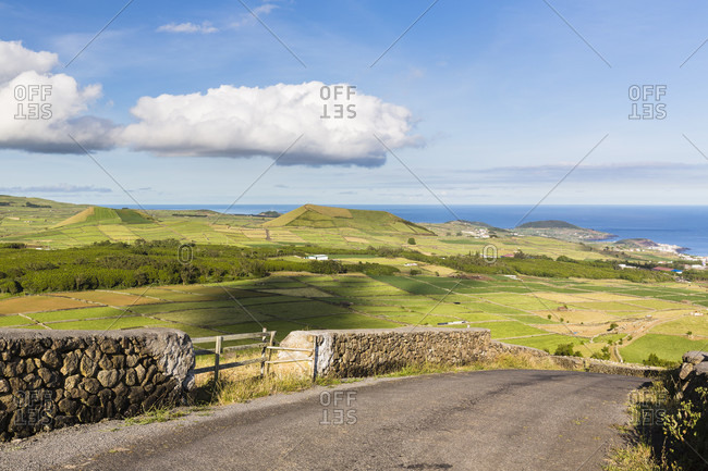 Rural road and elevated view on agricultural landscape with some volcano craters, serra da ribeirinha, Terceira, Azores, Portugal