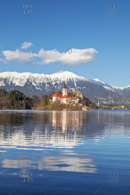 Bled island and lake bled with the snowy karawanks mountains on the background, bled, upper carniola region, slovenia, Europe
