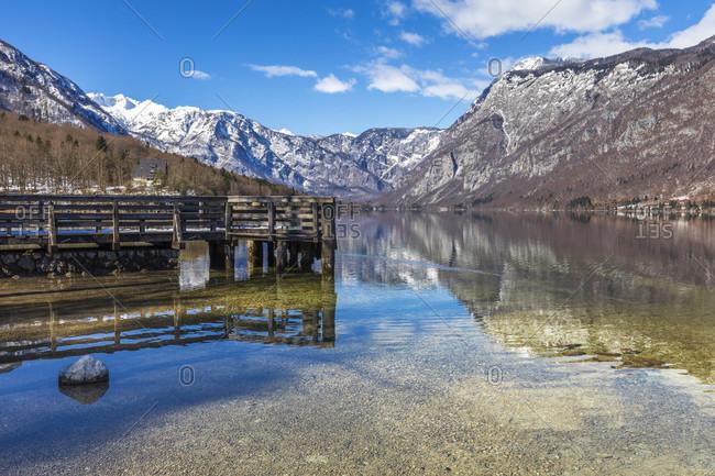 Bohinj lake and the snowy Julian alps on the background, ribbed laz, upper carniola, triglav national park, slovenia