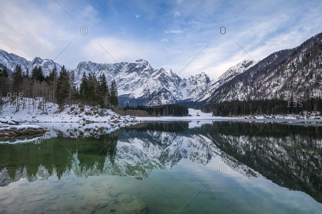 The upper lake of fusine with mount mangart on the background in winter. fusine lakes natural park, fusine di valromana, Tarvisio, Udine province, Friuli Venezia giulio, italy