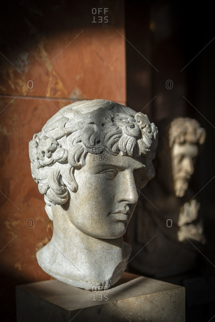 April 14, 2019: Antinous dionysos in the louvre, paris, france