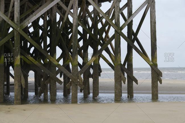 Stilts of beach houses, norderdeich, sankt peter-ording, north friesland, north sea, schleswig-holstein, Germany