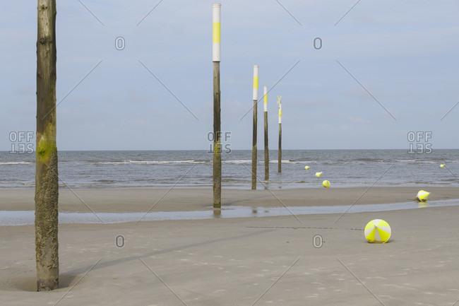 Sandy beach with buoy in summer, norderdeich, sankt peter-ording, north friesland, north sea, schleswig-holstein, Germany