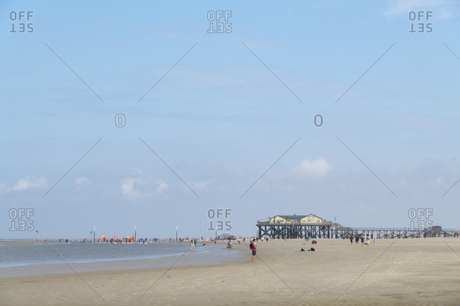 August 6, 2019: Sandy beach with beach houses in summer, norderdeich, sankt peter-ording, north friesland, north sea, schleswig-holstein, Germany