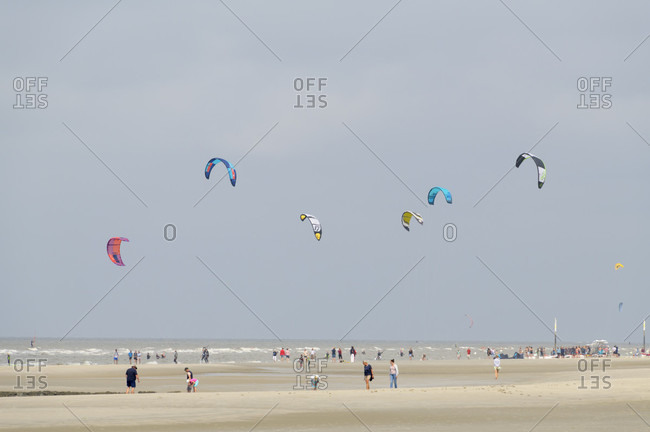 August 6, 2019: Sandy beach with people and kite surfer in summer, norderdeich, sankt peter-ording, north friesland, north sea, schleswig-holstein, Germany