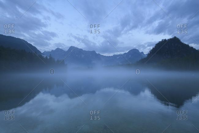 Mountain lake after rain in summer, almsee, almtal, upper austria, austria