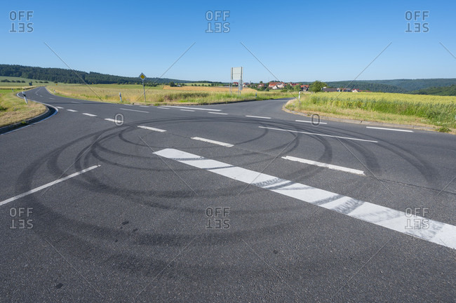 Street intersection with car tire marks