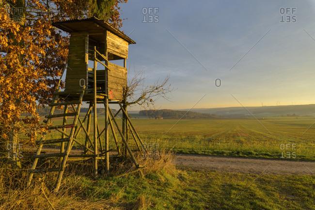 Hunting blind at sunrise, wall urn, Baden-Wurttemberg, Germany