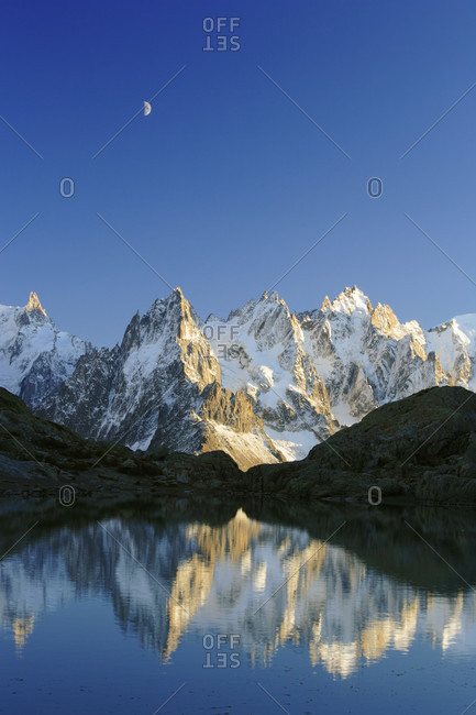 Lac blanc and aiguilles de mont blanc with moon, sunset, chamonix, france