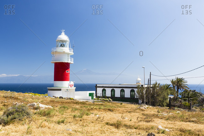 March 15, 2014: Lighthouse and view to mount teide on tenerife island