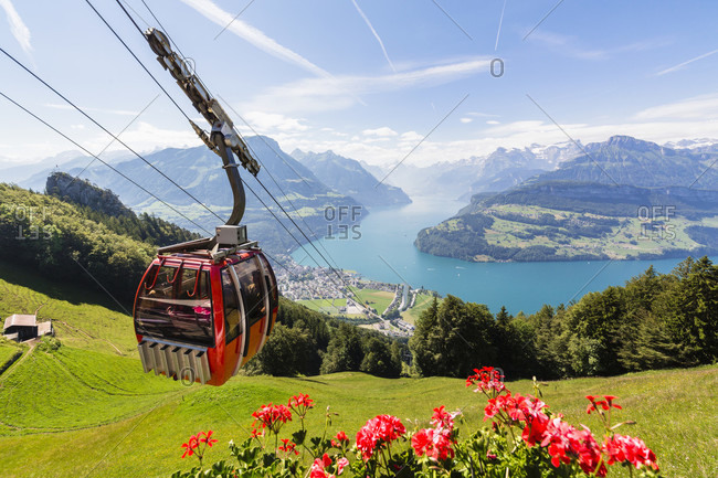 June 21, 2014: Overhead cable car at mount urmiberg, the backyard mountain above brunnen offers an open view on vierwaldstaettersee, mount urirotstock and mount oberbauen