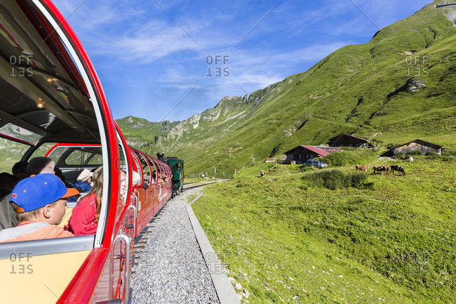 July 18, 2014: People enjyoing view and ride of the brienzer rothorn cog steam train, bernese oberland