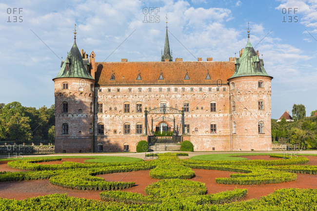 September 6, 2014: Formal gardens in front of egeskov castle, a moated castle, funen island