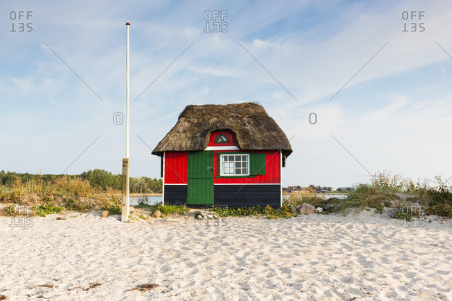 Thatched roof beach hut at a grass covered sand dune by the baltic sea, aero island