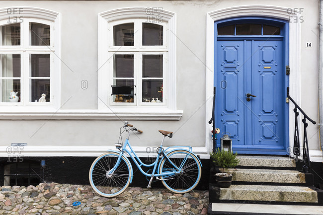 September 5, 2014: Bicycle in front of a house in a cobblestone alley of aeroskobing, aero island
