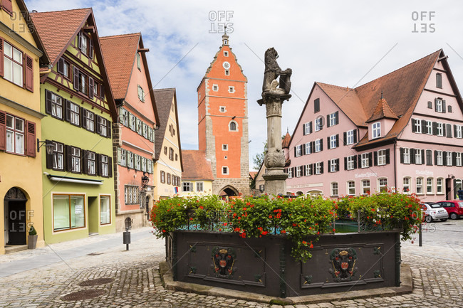 September 18, 2014: Lion fountain at the marketplace with wornitz turm tower and row of historic town houses with sharp gable, romantic road (romantische strasse), franconia