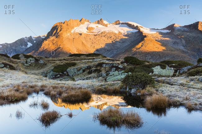 Pond in front of fusshoerner (3.627 m), aletsch glacier, jungfrau region, unesco world heritage region, autumn