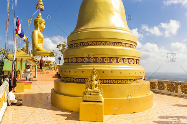 February 8, 2015: Golden buddha on the top ot fhe 1237 stairs walk, tiger cave temple wat tham sua
