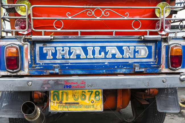 February 15, 2015: Tuk-tuk with thailand writing is a motorcycle rikshaw, perfect and cheap for short distance tours