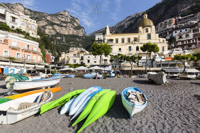 September 19, 2015: Fishing boats on the gravel beach in front of the village of positano on the amalfi coast
