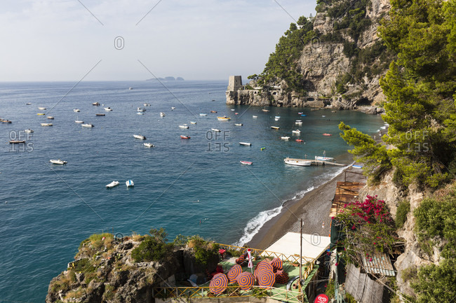 September 19, 2015: Moored fishing boats in front of the steep amalfi coast