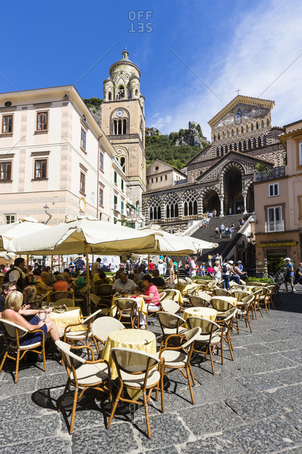 September 21, 2015: Amalfi cathedral and outside sitting of a restaurant on the square, unesco world heritage