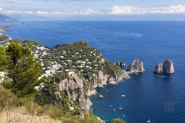 Elevated view on capri, the faraglioni cliffs
