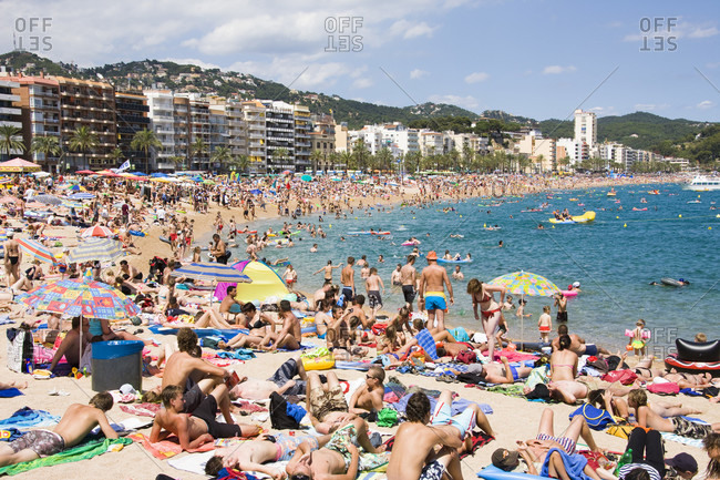 July 14, 2017: Crowded beach life in summer at lloret de mar