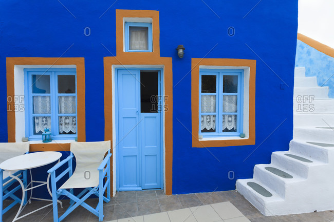 Blue painted house and white stairway, detail
