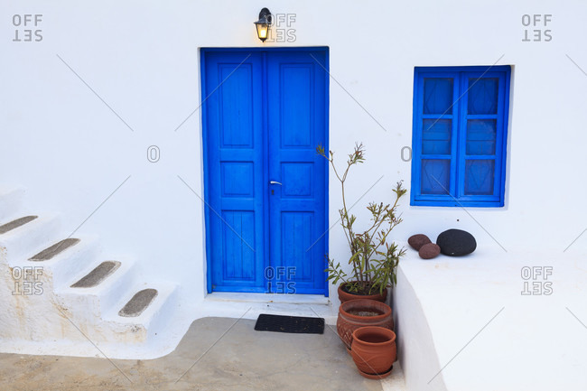 Typical blue painted door and window of a white washed santorin house