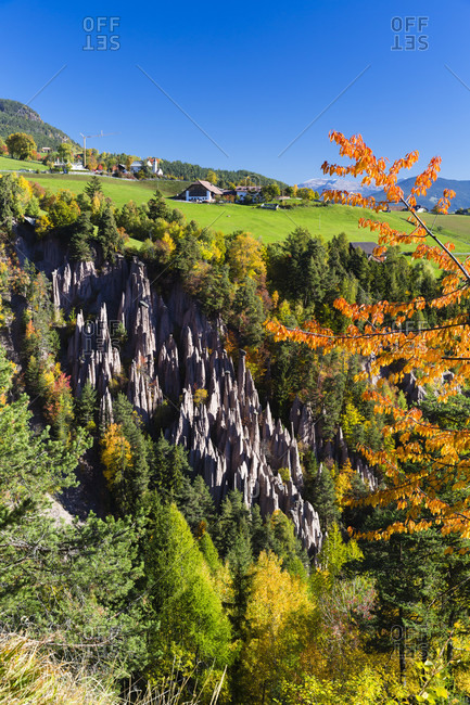 View over earth pyramids to the village of mittelberg, autumn