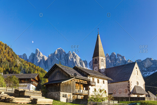 October 22, 2017: Santa madalena church in the vilnoess valley in front of mountains of the odle group/geislerspitzen, dolomites, autumn