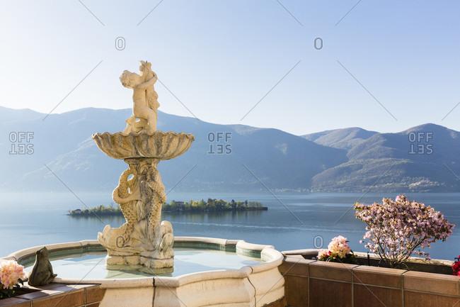 June 2, 2018: Sculpture in a little fountain above lago maggiore and isole di brissago, spring