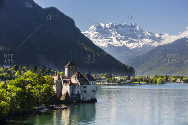 Chateau de chillon on lac leman (lake geneva) in front of the dent du midi, spring