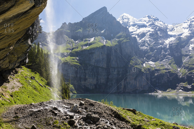 Lake oeschinensee within the mountains above kandersteg with its canadian wilderness charme