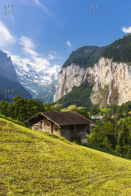 Steep cliffs framing the lauterbrunnen valley and its alpine pastures