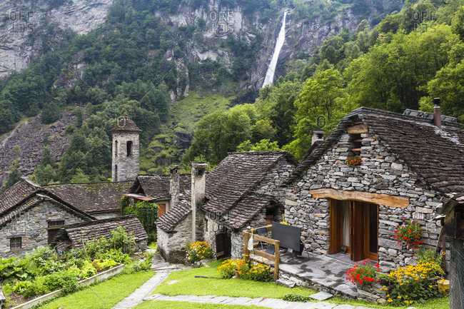 Medieval village with typical rustic stone houses and the waterfall foroglio, bavona valley