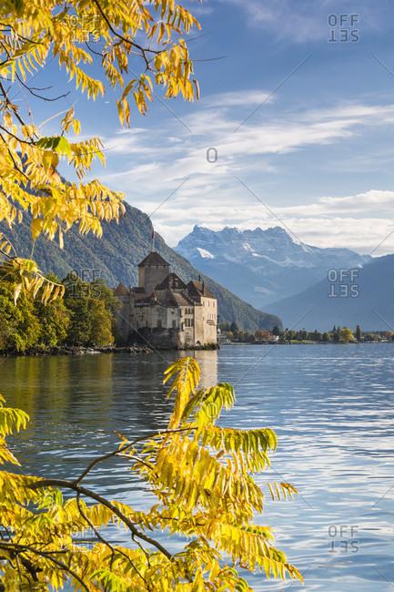 Chateau de chillon (chillon castle) against the alps (dents du midi), autumn