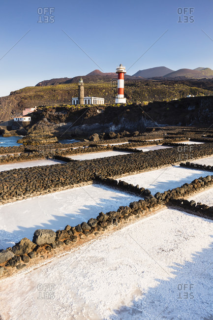 Old and new lighthouse at the salinas de fuencaliente, volcanoes in the background